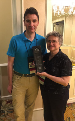 Iain Davis (l), assistant dean of admissions, and Yvonne Cherena-Pacheco, associate director of admissions, accepted the Diversity Matters award at the LSAC conference.
