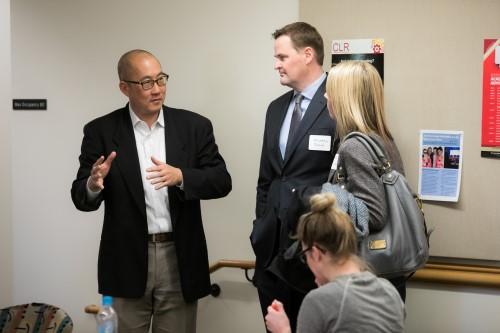 Professor and DEJI Co-Director Bernard Chao in deep discussion with alumni, Michael Dulin