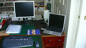 May 1, 2006 - Judge Edward's fascination with technology: 2 computer screens rather than 1