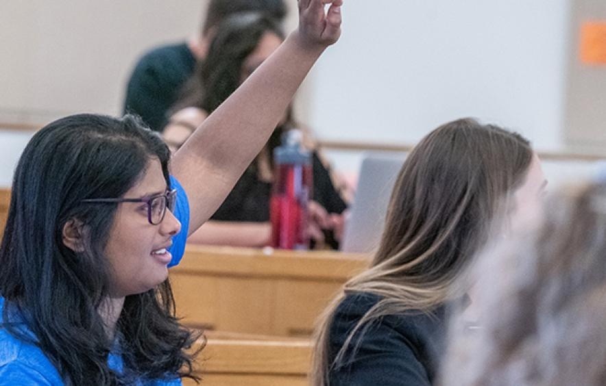 Female law student raising hand