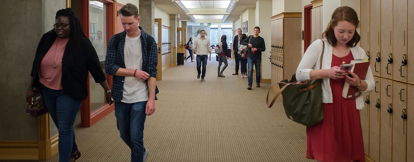 Denver Law students walking in law building
