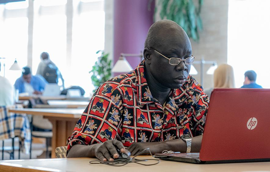 male student working online